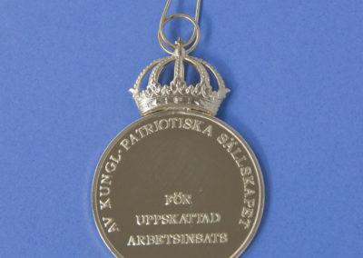 Medalj för betydande arbetsinsats, baksida